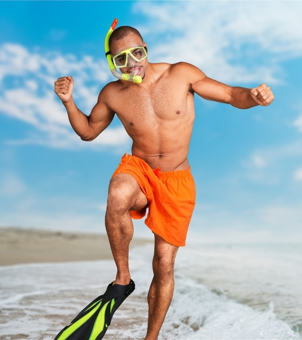 man with a snorkel in a studio with a chosen aesthetic background image