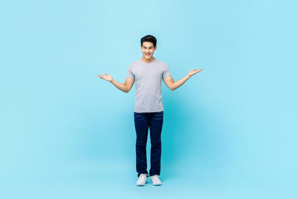 asian guy in plain blue background - add background images